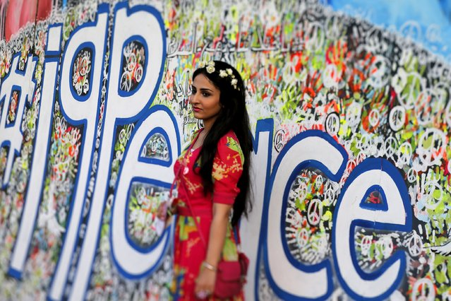 An Iraqi woman attends a festival commemorating the International Day of Peace in Baghdad, September 21, 2015. (Photo by Thaier al-Sudani/Reuters)