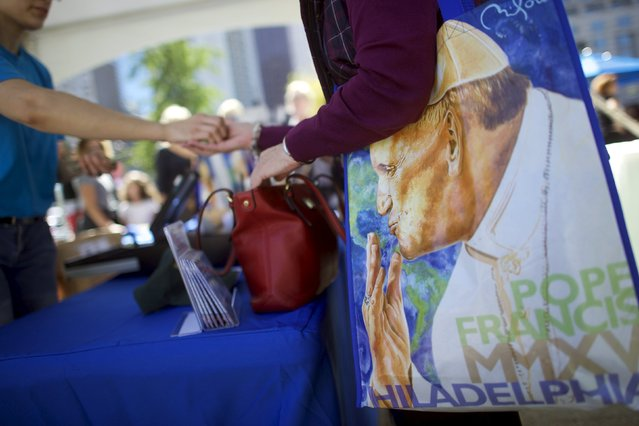 Souvenirs of Pope Francis are sold across the street from the Cathedral Basilica of Saints Peter and Paul, the first site the pontiff will visit in Philadelphia, Pennsylvania, September 23, 2015.  The events expected to draw the biggest crowds during Pope Francis' six-day visit to the United States all occur in Philadelphia, September 26-27. (Photo by Mark Makela/Reuters)