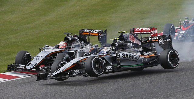 Force India Formula One driver Sergio Perez of Mexico (11) is seen after fighting for position with Williams Formula One driver Felipe Massa (not pictured) of Brazil at the start of the Japanese F1 Grand Prix at the Suzuka circuit in Suzuka, Japan, September 27, 2015. At left is Force India Formula One driver Nico Hulkenberg of Germany. (Photo by Toru Hanai/Reuters)