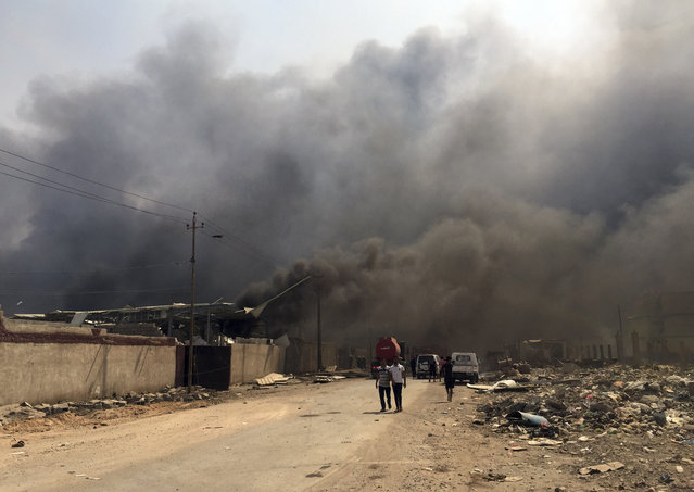 Smoke rises after explosions eastern Baghdad, Iraq, Friday, September 2, 2016. (Photo by Khalid Mohammed/AP Photo)
