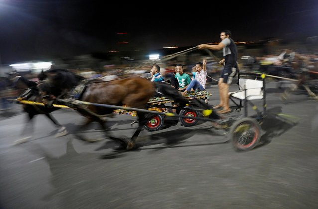 Egyptian merchants are seen in action during a horse cart race showing off their horses's strengths, following the outbreak of the coronavirus disease (COVID-19), in Cairo, Egypt, July 17, 2020. (Photo by Mohamed Abd El Ghany/Reuters)