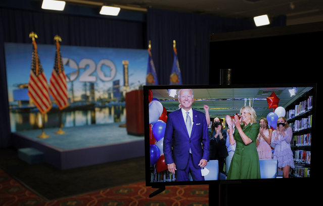 Democratic presidential candidate former Vice President Joe Biden is seen in a video feed from Delaware as he reacts with his wife Jill Biden and his grandchildren at his side, after winning the votes to become the Democratic Party's 2020 nominee for President, during the second night of the virtual 2020 Democratic National Convention in Milwaukee, Wisc., Tuesday, August 18, 2020. (Photo by Brian Snyder/Pool via AP Photo)