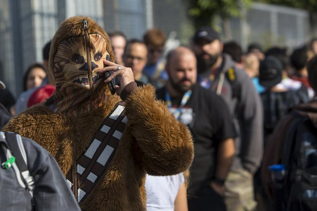 A man dressed as Chewbacca from the Star Wars series speaks on his cell phone as he arrives for New York Comic Con in Manhattan, New York, October 8, 2015. (Photo by Andrew Kelly/Reuters)
