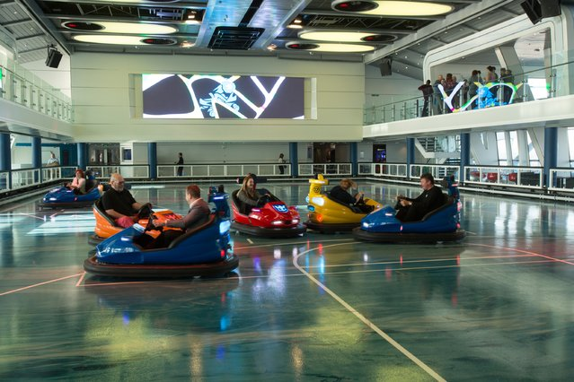 People sit in dodgem cars onboard the cruise ship Quantum of the Seas which is currently docked at Southampton on October 31, 2014 in Southampton, England. (Photo by Matt Cardy/Getty Images)