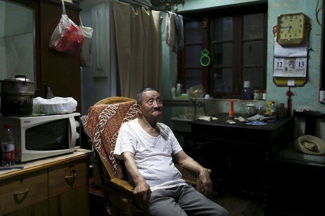 """Wang Cunchun, 90, watches news about stocks on TV at his home in Shanghai, China, July 14, 2015. When Wang retired from a stationery store he didn't have much to do. He first invested in stocks in the 1990s. """"Trading stocks is my biggest hobby. I never wanted to make a fortune from stocks. I have 3000 yuan pension every month, Wang said. He currently lives with his 60-year-old son in an around 10-square-meter apartment. (Photo by Aly Song/Reuters)"""