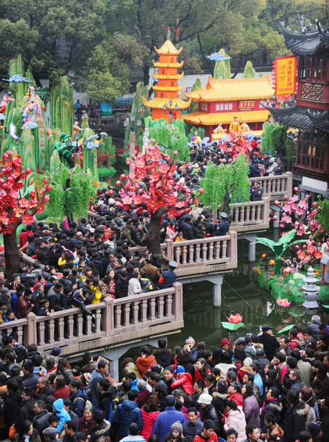People visit a lantern show to celebrate Chinese Lunar New Year of Snake at Yuyuan Garden on February 11, 2013 in Shanghai, China. (Photo by VCG/VCG via Getty Images)