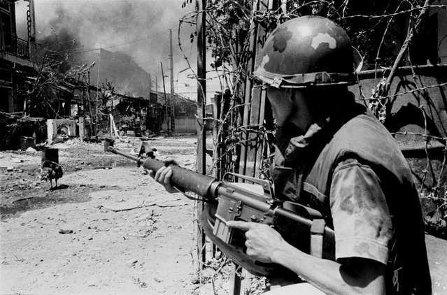 In this early 1968 file photo, a South Vietnamese soldier takes a position on a Saigon street during the Tet Offensive. Early on the morning of January 31, 1968, as Vietnamese celebrated the Lunar New Year, or Tet as it is known locally, Communist forces launched a wave of coordinated surprise attacks across South Vietnam. The campaign, one of the largest of the Vietnam War, led to intense fighting and heavy casualties in cities and towns across the South. (Photo by Nick Ut/AP Photo)
