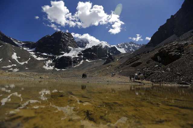 """A view of """"La Paloma"""" glacier (C) next to the open pits of CODELCO'S Andina and Anglo American's Los Bronces copper mines (not pictured) at Los Andes Mountain range, near Santiago city, November 17, 2014. (Photo by Ivan Alvarado/Reuters)"""