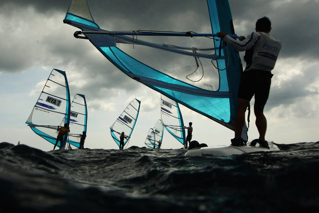 Competitors race in the Men's RS-One Windsurfing class during the 2014 Asian Beach Games at Karon Beach on November 16, 2014 in Phuket, Thailand. (Photo by Cameron Spencer/Getty Images)