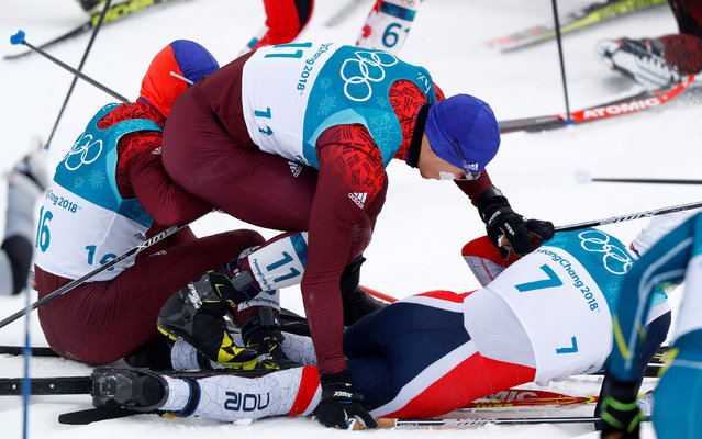 Russia' s Denis Spitsov, Russia' s Andrey Larkov and Norway' s Simen Hegstad Krueger take collide at the start of the men' s 15 km + 15 km cross- country skiathlon at the Alpensia cross country ski centre during the Pyeongchang 2018 Winter Olympic Games on February 11, 2018 in Pyeongchang. (Photo by Kai Pfaffenbach/Reuters)