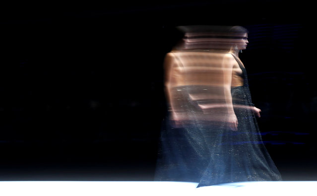 A model presents a creation from the Giorgio Armani Autumn/Winter 2018 women collection during Milan Fashion Week in Milan, Italy February 24, 2018. (Photo by Alessandro Garofalo/Reuters)