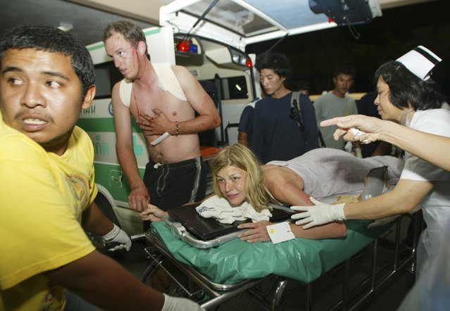 An injured tourist is sent to a hospital after a tsunami hit Phuket, south of Bangkok, in this December 26, 2004 file photo. (Photo by Chaiwat Subprasom/Reuters)