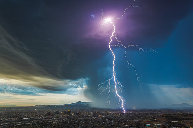 """""""A Predawn Thunderstorm Over El Paso"""". A storm breaks over the desert and downtown area of the Texan city. (Photo by Lori Grace Bailey/Royal Meteorological Society's Weather Photographer of the Year Awards)"""