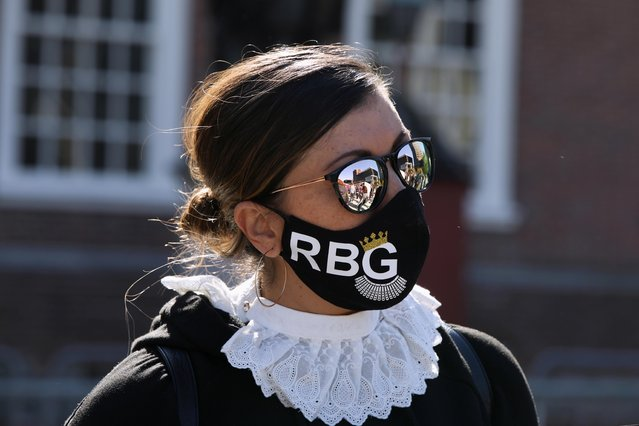 Andrea Towson takes part in a Women's March as part of a nationwide protest against President Donald Trump's decision to fill the seat on the Supreme Court left by the late Justice Ruth Bader Ginsburg before the election, in Philadelphia, Pennsylvania, U.S. October 17, 2020. (Photo by Rosem Morton/Reuters)