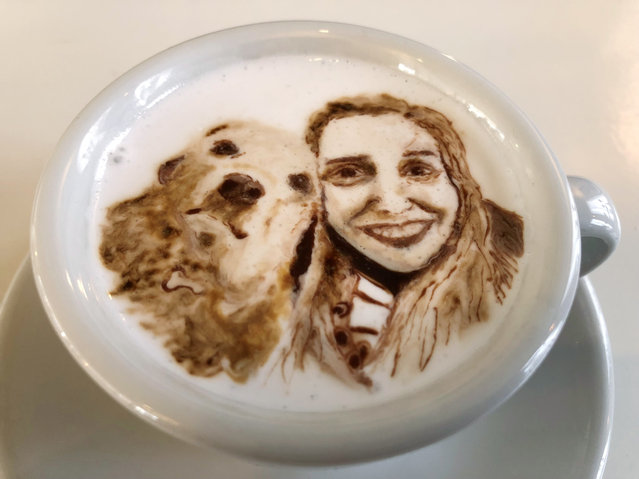 This March 1, 2018, photo shows a portrait of Associated Press writer Ashley Thomas with her dog Sandra, designed atop a cup of cold java by Barista Lee Kang Bin at his coffee shop in Seoul, South Korea. The South Korean barista is charming customers at his coffee shop by drawing intricate artworks on the foamy cream toppings of their drinks. (Photo by Dino Hazell/AP Photo)