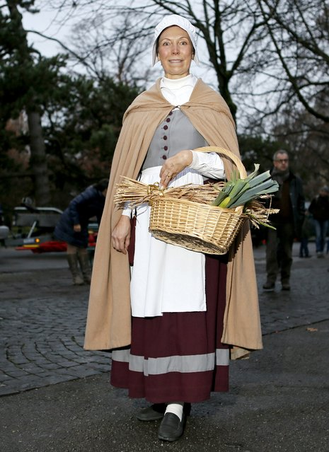 A member of Compagnie 1602 playing the role of a farmer poses before a procession in Geneva December 14, 2014. (Photo by Pierre Albouy/Reuters)