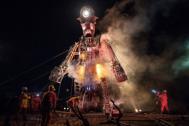 "The Man Engine, the largest mechanical puppet ever constructed in the UK, is unveiled during a final dress rehearsal of the ""Afterdarker"" ceremony ahead of the start of his Resurrection Tour which will kick off on Saturday at Geevor Tin Mine near St Just on March 29, 2018 in Cornwall, England. Last seen in 2016, to mark the 10th anniversary of the Cornwall and West Devon Mining Landscape being added to the UNESCO list of World Heritage Sites, the 11.2 metre tall puppet will start his tour at the Cornish Mining World Heritage Site landscape on Saturday, before travelling to other iconic industrial heritage sites in Cornwall, Devon, Somerset, making various stops in South Wales before heading for Shropshire, Yorkshire and Durham. (Photo by Matt Cardy/Getty Images)"