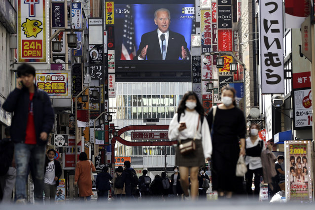 In this November 8, 2020, file photo a screen shows a live broadcast of President-elect Joe Biden speaking at the Shinjuku shopping district in Tokyo. (Photo by Kiichiro Sato/AP Photo/File)