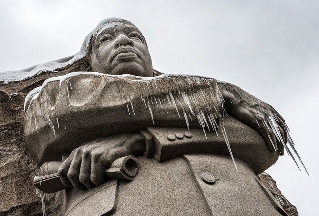 Icicles form on the statue of Rev. Martin Luther King as snow once again blankets the city on March, 17, 2014 in Washington, DC. (Photo by Bill O'Leary/The Washington Post)
