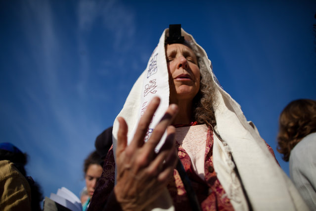 """Members of the religious group """"Women Of The Wall"""" hold a prayer service to mark the first day of the Jewish month of Sivan at the Western Wall on May 10, 2013 in Jerusalem, Israel. Thousands of ultra-Orthodox protestors clashed with Israeli police during the first monthly prayer service to be held by Women Of The Wall following the recent landmark ruling by Jerusalem District Court allowing women to wear prayer shawls at the Western Wall. (Photo by Uriel Sinai/Getty Images)"""