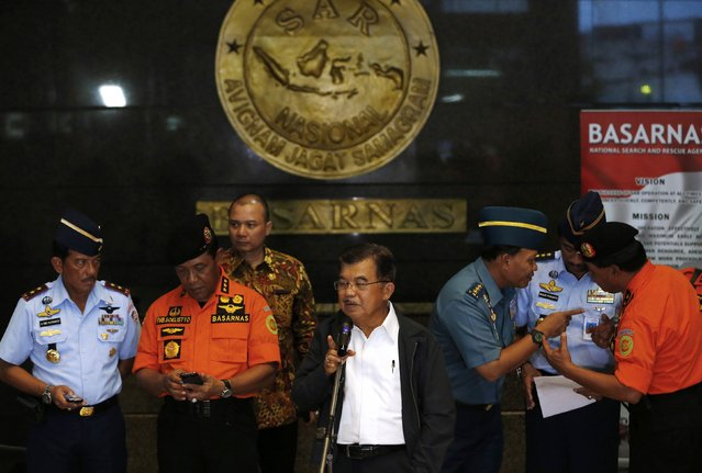 Indonesia's vice-president Jusuf Kalla (C) speaks to the media regarding AirAsia Flight QZ8501 during a visit to the National Search and Rescue Agency in Jakarta December 28, 2014. (Photo by Darren Whiteside/Reuters)