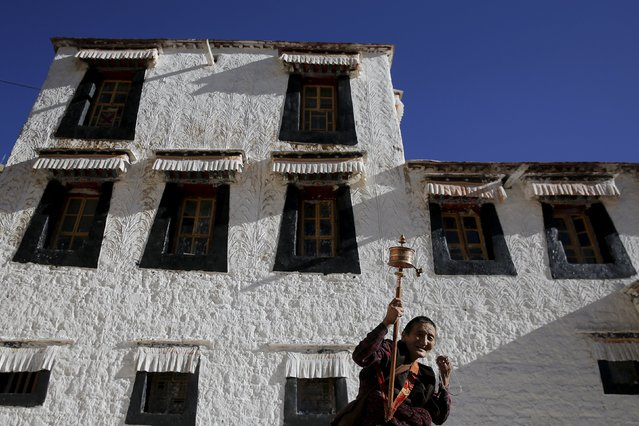 A Tibetan women spins a prayer wheel at Buddhist Sera monastery in Lhasa, Tibet Autonomous Region, China November 19, 2015. (Photo by Damir Sagolj/Reuters)