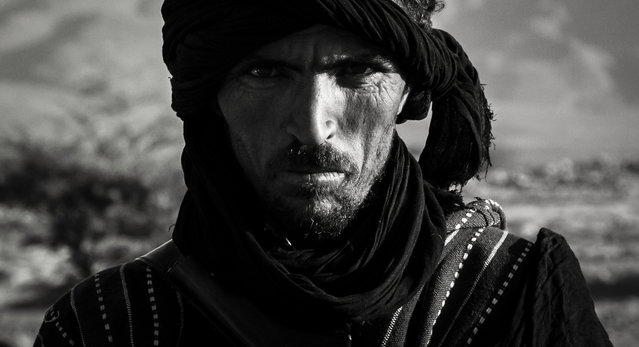 """""""Berber"""". A wandering Berber in the Sahara, Morocco. He was walking from his village, and had been sleeping in the desert for several days and was about the reach a nearby town for his first proper meal. (Photo and caption by Filip Gierlinski/National Geographic Traveler Photo Contest)"""