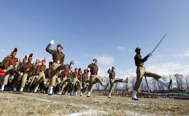 Indian policemen march during a Republic Day parade in Srinagar January 26, 2015. (Photo by Danish Ismail/Reuters)