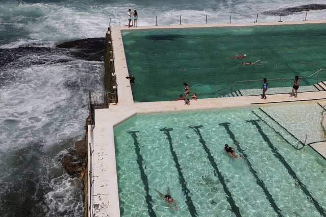 People soak up the sun at an oceanside swimming pool by Bondi Beach on the first day of summer in Sydney, Australia, December 1, 2020. (Photo by Loren Elliott/Reuters)