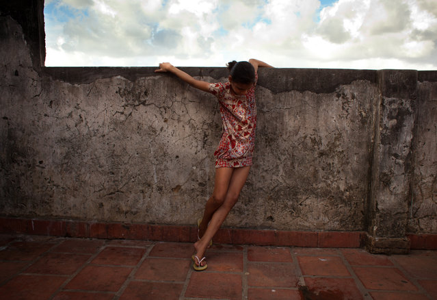 """Lighter than her Life"". Christiane, a child of the Roofless Movement in Salvador Brazil. A beautiful spirit living a life not hers by choice, but she brings love and light to all around her. (Photo and caption by Geralyn Shukwit/National Geographic Traveler Photo Contest)"