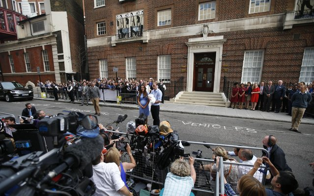 Britain's Prince William and Kate, Duchess of Cambridge hold the Prince of Cambridge, Tuesday July 23, 2013, as they pose for photographers outside St. Mary's Hospital exclusive Lindo Wing in London where the Duchess gave birth on Monday July 22. The Royal couple are expected to head to London's Kensington Palace from the hospital with their newly born son, the third in line to the British throne. (Photo by Lefteris Pitarakis/AP Photo)