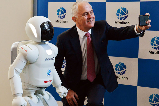 Australian Prime Minister Malcolm Turnbull takes a selfie photograph with the robot Asimo at the National Museum of Emerging Science and Innovation on December 18, 2015 in Tokyo, Japan. (Photo by Yoshikazu Tsuno-Pool/Getty Images)