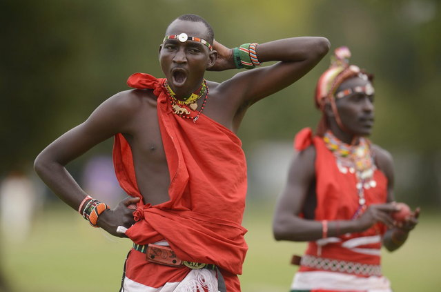 "Members of the Maasai Cricket Warriors team from Kenya warm up before a match against English team ""The Shed"" during the ""Last Man Stands"" cricket tournament at Dulwich sports ground in South London September 1, 2013. (Photo by Philip Brown/Reuters)"