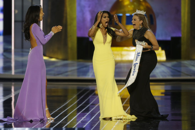 Miss New York Nina Davuluri, center, reacts after being named Miss America 2014 pageant as Miss California Crystal Lee, left, and Miss America 2013 Mallory Hagan celebrate with her, Sunday, September 15, 2013, in Atlantic City, N.J. (Photo by Mel Evans/AP Photo)