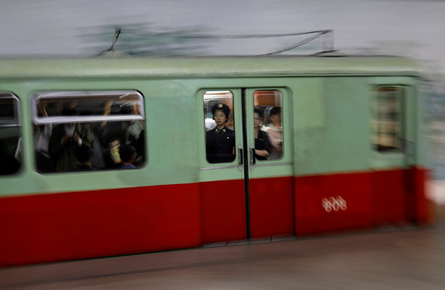 Commuters travel in a train as it leaves a subway station in Pyongyang, North Korea on September 11, 2018. (Photo by Danish Siddiqui/Reuters)