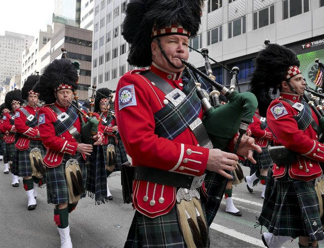 Bagpipers march in the St. Patrick's Day Parade in New York, Tuesday, March 17, 2015. (Photo by Seth Wenig/AP Photo)