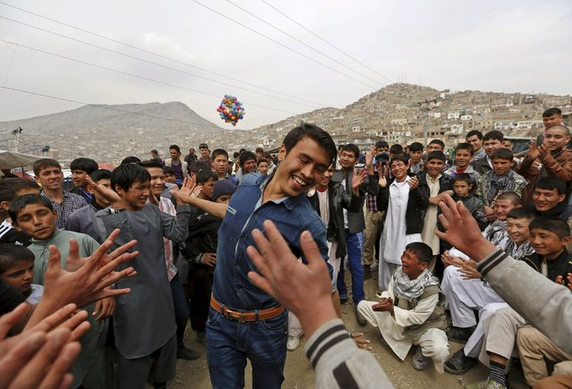 A man dances during celebrations for Afghan New Year (Newroz) in Kabul March 21, 2015. (Photo by Mohammad Ismail/Reuters)