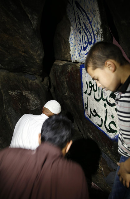 "Muslim pray at the Hera cave in Mount Al-Noor during their Umrah Mawlid al-Nabawi ""Birthday of Prophet Mohammad"" in the holy city of Mecca, Saudi Arabia, January 16, 2016. (Photo by Amr Abdallah Dalsh/Reuters)"