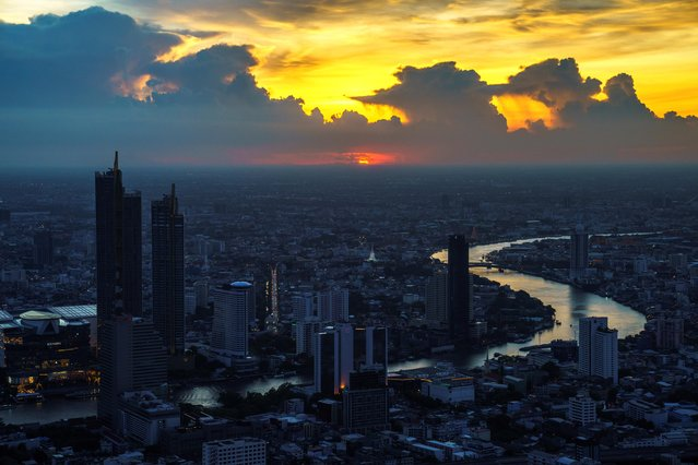 The skyline with Chao Phraya River is photographed during sunset in Bangkok, Thailand, June 2, 2021. (Photo by Athit Perawongmetha/Reuters)