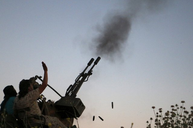 Tajammu Al-Ezza brigade fighters fire an anti-aircraft weapon towards what activists said were helicopters loyal to Syria's president Bashar Al-Assad located in Hama countryside May 6, 2015. (Photo by Mohamad Bayoush/Reuters)