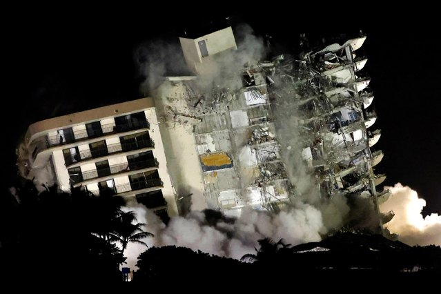 The partially collapsed Champlain Towers South residential building is demolished amid worries that high winds from Tropical Storm Elsa could knock it down, in Surfside, Florida, July 4, 2021. Days later, officials called off the search for survivors, saying there was no longer any hope of pulling someone alive from the ruins of the flattened building. (Photo by Marco Bello/Reuters)