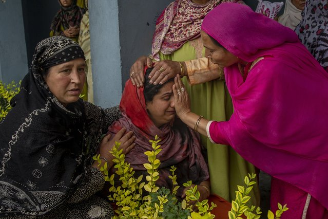 A Kashmiri villager cries beside her home that was destroyed in a gunfight after suspected rebels took refuge in it, in Pulwama, south of Srinagar, Indian controlled Kashmir, Wednesday, July 14, 2021. (Photo by Dar Yasin/AP Photo)