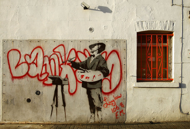 A painting attributed to Banksy on a wall in Portobello Road, west London, in 2008. (Photo by Dylan Martinez/Reuters)