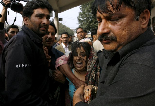A woman mourns the death of her relative, who was killed in an explosion outside police headquarters, at hospital in Lahore, February 17, 2015. A Taliban suicide bomber on Tuesday killed six people and himself in a brazen attack on police headquarters in Pakistan's eastern city of Lahore, in what militants called a revenge bid for the recent hangings of colleagues. (Photo by Mani Rana/Reuters)