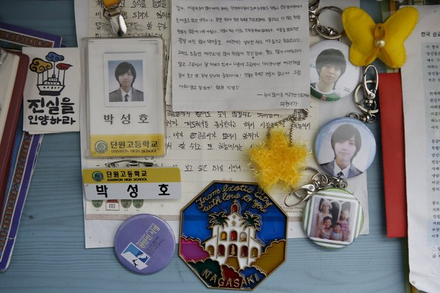 Student identification, letters from a schoolmate and other belongings are seen on a desk in a room belonging to Park Sung-ho, a high school student who died in the Sewol ferry disaster, in Ansan April 7, 2015. His dream was to be a priest. (Photo by Kim Hong-Ji/Reuters)