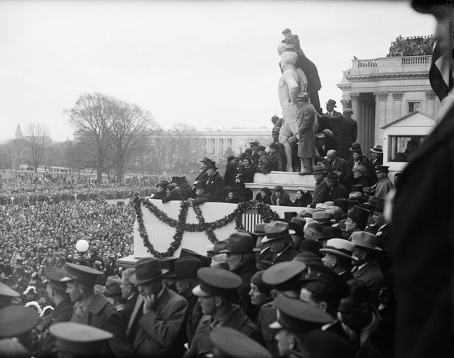 Onlookers stand where they can view the inauguration of Franklin D. Roosevelt in Washington, D.C., U.S. in March 1933. (Photo by Reuters/Library of Congress)