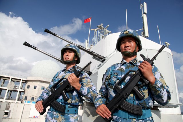 Soldiers of China's People's Liberation Army (PLA) Navy stand guard in Nansha Islands February 10, 2016. (Photo by Reuters/Stringer)