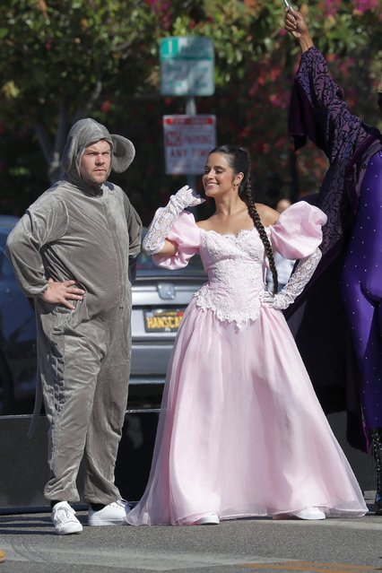 Cuban-born American singer Camila Cabello performs wearing a Cinderella costume as James Corden, dressed as a mouse, Idina Kim Menzel, and Billy Porter, dance in the middle of the street while filming a skit for The Late Late Show in Los Angeles, CA. on August 27, 2021. (Photo by Backgrid USA)