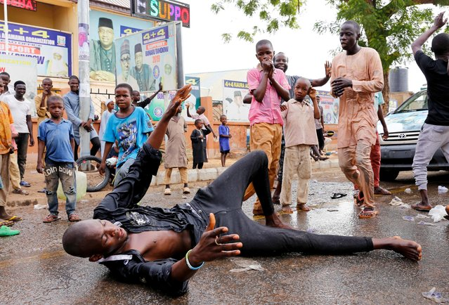 A supporter of President Muhammadu Buhari dances on the ground as he celebrates with others in Yola, Adamawa State, Nigeria on February 27, 2019. (Photo by Nyancho NwaNri/Reuters)
