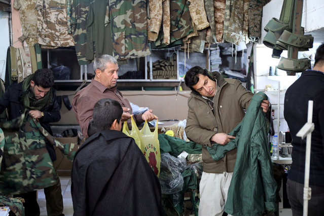 Kurdish people shop for female military uniforms in Erbil, Iraq January 24, 2017. (Photo by Marius Bosch/Reuters)